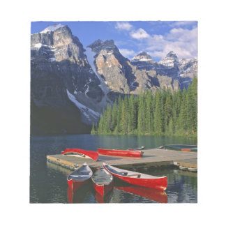 Canada, Alberta, Moraine Lake. Red canoes await Notepad