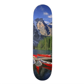 Canada, Alberta, Moraine Lake. Red canoes await Skate Decks