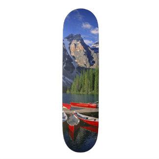 Canada, Alberta, Moraine Lake. Red canoes await Skate Decks