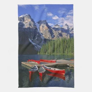 Canada, Alberta, Moraine Lake. Red canoes await Tea Towel