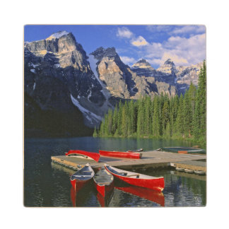 Canada, Alberta, Moraine Lake. Red canoes await Wood Coaster