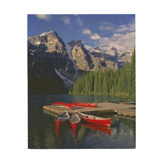 Canada, Alberta, Moraine Lake. Red canoes await Wood Print