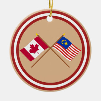 Canada and Malaysia Crossed Flags Christmas Ornament