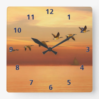 Canada Geese in Flight at Sunset Square Wall Clock