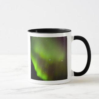 Canada, Manitoba, Churchill. Aurora Borealis in Mug