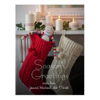 Candles lit on mantelpiece with Christmas Postcard