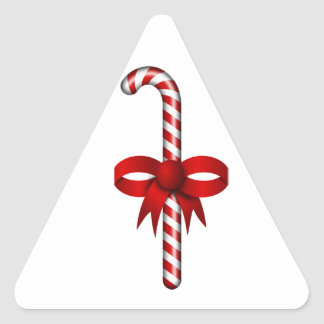 Candy Cane with Red Ribbon Bow Tied Around It Triangle Sticker