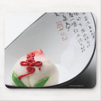 Candy flower bud in bowl mouse mat