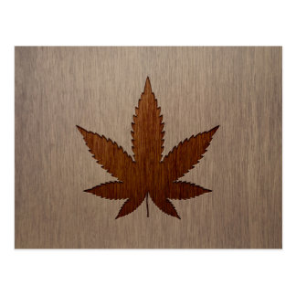 Cannabis leaf engraved on wood design postcard