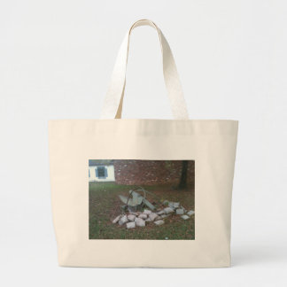 Cannon wreck; peace symbol bags