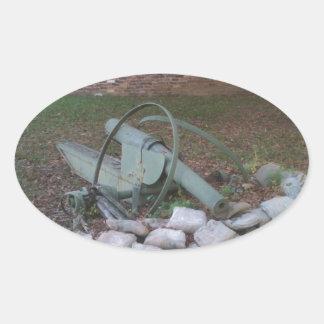 Cannon wreck; peace symbol sticker
