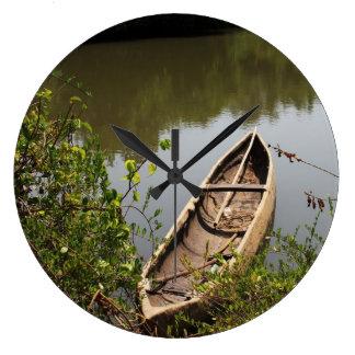 canoe clock on the lake