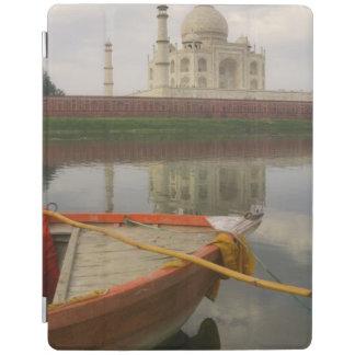 Canoe in water with Taj Mahal, Agra, India iPad Cover