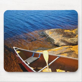 Canoe on shore mousepads