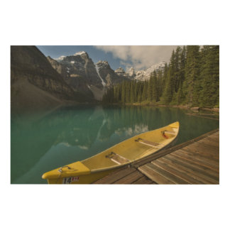 Canoe parked at a dock along Moraine Lake, Banff Wood Wall Art