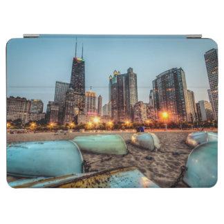 Canoes on Oak Street Beach a little after sunset iPad Air Cover