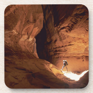 Canyoneer illuminated in the depths of a narrow beverage coasters