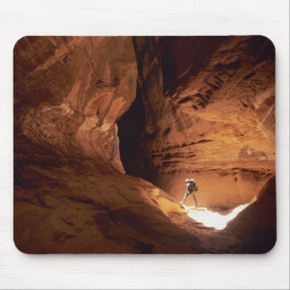 Canyoneer illuminated in the depths of a narrow mouse mat