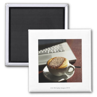 Cappuccino in front of laptop refrigerator magnet