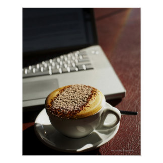 Cappuccino in front of laptop poster