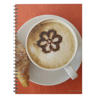 Cappuccino with chocolate and a croissant, Italy Notebook