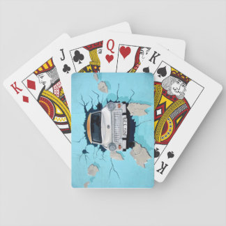 Car crosses a wall playing cards