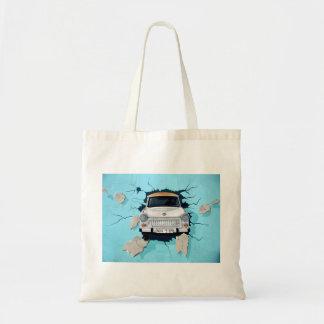 Car crosses a wall tote bag
