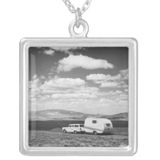 Car pulling trailer on road silver plated necklace