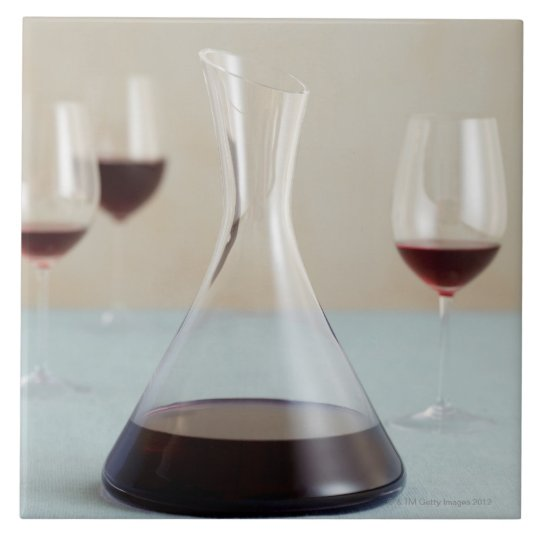 Carafe of red wine large square tile