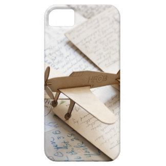 Carboard airplane on postcards iPhone 5 covers