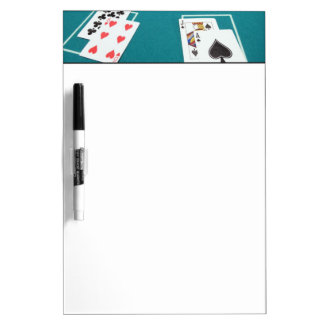 Cards and chips on betting table dry erase board