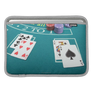 Cards and chips on betting table MacBook sleeve