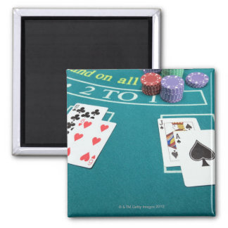 Cards and chips on betting table square magnet