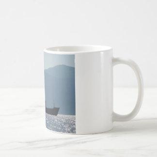 Cargo Ship Silhouetted By The Sun Coffee Mug