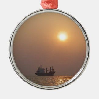 Cargo Ship Under A Hazy Sun Silver-Colored Round Decoration