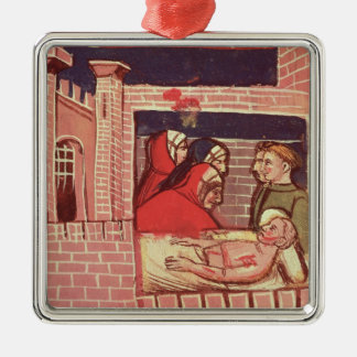Caring for an injured man in a castle christmas ornament