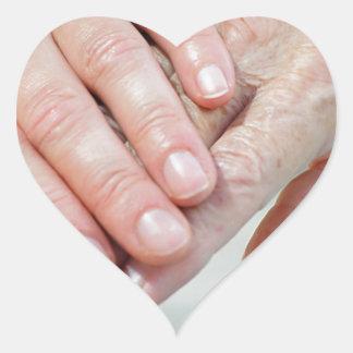 caring hands heart sticker