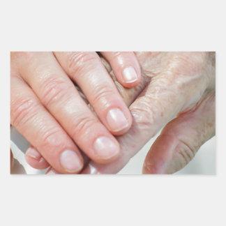 caring hands rectangular sticker