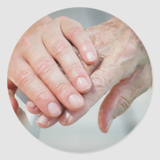 caring hands round sticker