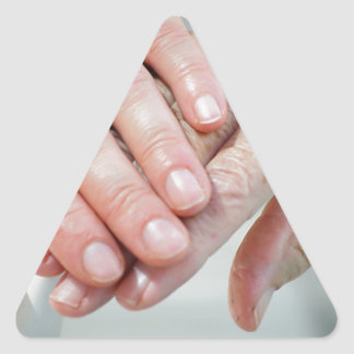 caring hands triangle sticker