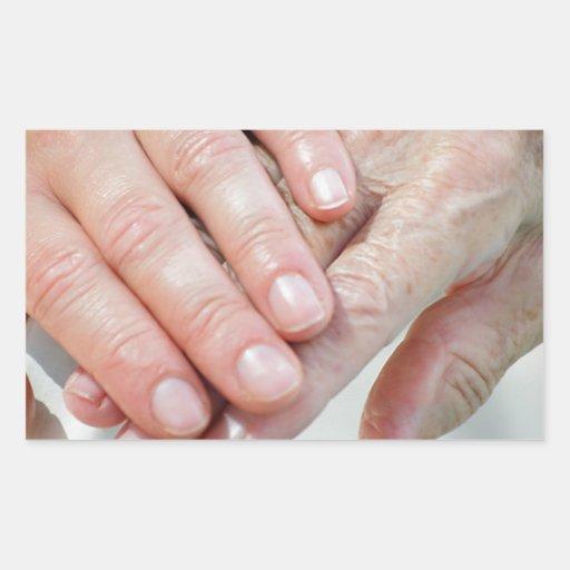 caring hands rectangular stickers
