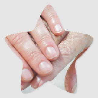 caring hands star sticker