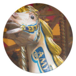 Carousel horse on merry goround plate