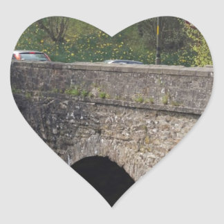 Cars crossing the stone bridge over river Teith Stickers