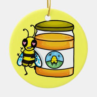 Cartoon bee leaning on honey jar christmas ornament