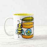 Cartoon bee leaning on honey jar coffee mugs
