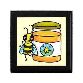 Cartoon bee leaning on honey jar gift box