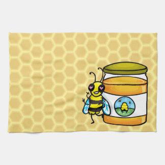 Cartoon bee leaning on honey jar tea towel