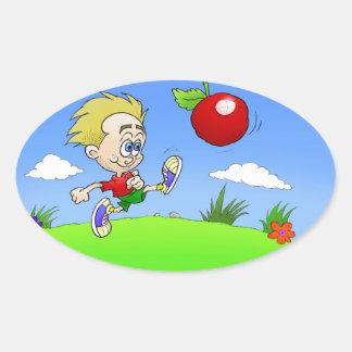 Cartoon illustration of a boy kicking a tomato. oval sticker