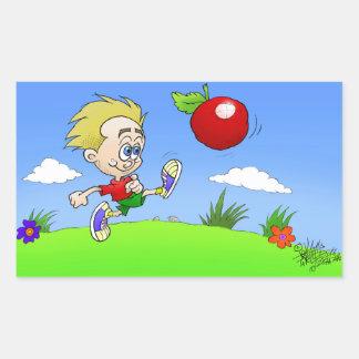 Cartoon illustration of a boy kicking a tomato. rectangular sticker